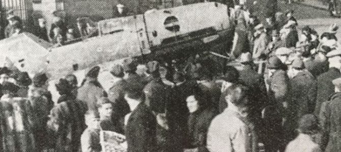 Photograph of people gathered around a captured German aircraft.