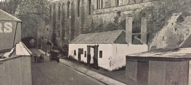 Very old image of Monastery Street with the buildings in the foreground of the p…